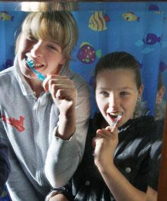 The kids brushing their teeth